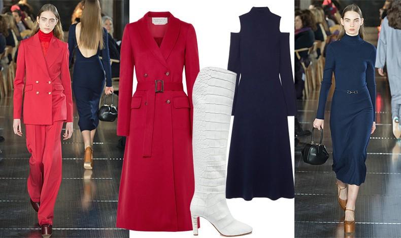 Από την επίδειξη για τη συλλογή φθινόπωρο 2018-χειμώνας 2019 // Κόκκινη καμπαρντίνα, μακρύ σκούρο μπλε φόρεμα με ιδιαίτερα κοψίματα στους ώμους και εντυπωσιακή λευκή μπότα από τη φετινή συλλογή // Μία ακόμη δημιουργία της για τον φετινό χειμώνα