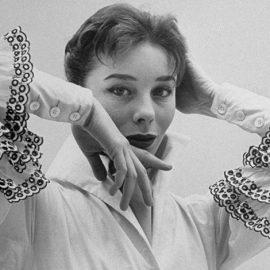 Με μοντέλο την περίφημη Bettina Graziani (γνωστή και ως μόνο Bettina), εισήγαγε για παράδειγμα την περίφημη λευκή μπλούζα με τα μανίκια με βολάν χαρίζοντας μία νέα πνοή στη μόδα το 1952