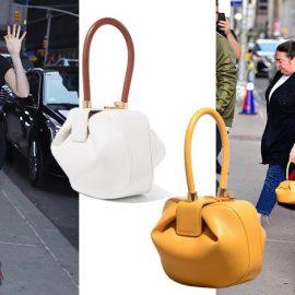 Η Χίλαρι Σουάνκ με κλασική μαύρη «Nina» // Σε λευκό με κοκάλινο χερούλι ή στο φωτεινό κίτρινο όπως της Αν Χάθαγουέι;