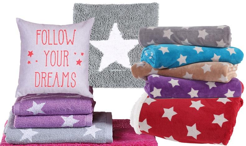 Γεμίστε τη ζωή σας αστέρια! Follow your dreams, διακοσμητικό μαξιλάρι 45x45εκ., 12,50? // Ταπέτο μπάνιου Realta 70x70 εκ., 15,00? // Πετσέτα προσώπου με αστέρια, 10,50? και πετσέτα μπάνιου, 21,50? // Κουβέρτα μονή, 26,00? και υπέρδιπλη, 42,00? // Κόκκινη κουβέρτα καναπέ με γουνάκι, 29,00?
